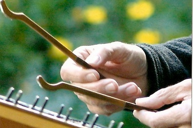 playing the hammered dulcimer