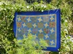 Blue quilt with yellow stars